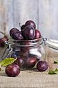Preserving jar of plums on jute - ODF000807
