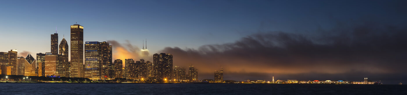 USA, Illinois, Chicago, skyline with Lake Michigan at dusk - FOF006874