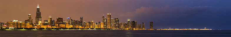 USA, Illinois, Chicago, skyline with Lake Michigan at dusk - FOF006882