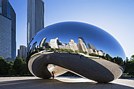 USA, Illinois, Chicago, view to Cloud Gate with reflections of skyscrapers on AT and T Plaza at Millennium Park - FO006976