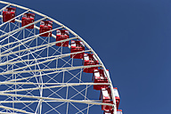 Ferris wheel against blue sky - FOF007134