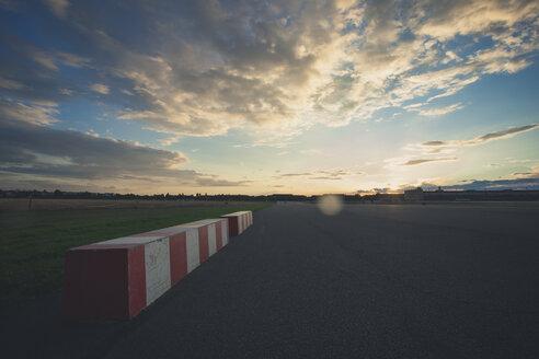 Germany, Berlin, Tempelhofer Feld, former Berlin Tempelhof airport former runway at sunset - ZMF000337