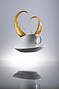 Coffee splashing in cup - KSWF001321