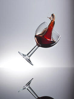 Red wine shaking in glass - KSWF001325
