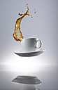 Coffee splashing in cup - KSWF001327
