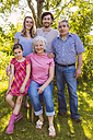 Portrait of three generation family in garden - MFF001287