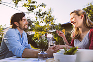Couple having dinner in garden - MFF001312