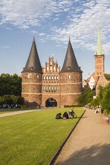 Germany, Schleswig-Holstein, Luebeck, Holsten Gate, Saint Peter's Church in the background - KRP001025