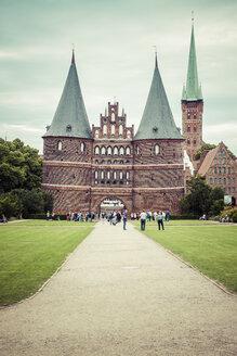 Germany, Schleswig-Holstein, Luebeck, Holsten Gate, Saint Peter's Church in the background - KRPF001027