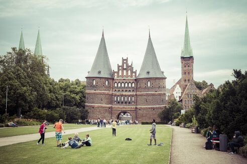 Germany, Schleswig-Holstein, Luebeck, Holsten Gate, Saint Peter's Church and Saint Mary's Church in the background - KRP001028