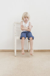 Portrait of defiant little boy with crossed arms - MJF001330