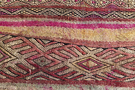 Morocco, Marrakesh, detail of a traditionally Moroccan carpet - KMF001477