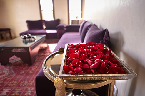 Morocco, Fes, tray of red rose petals in a suite of Hotel Riad Fes - KMF001484