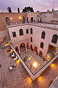 Morocco, Fes, Hotel Riad Fes, lightened courtyard at twilight - KMF001425