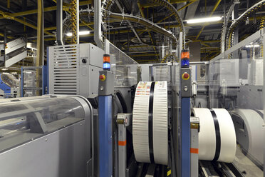 Germany, Machine with brochures in a pressing shop - SCH000390
