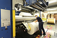 Germany, Presses with rolls of paper in a printing shop - SCH000393