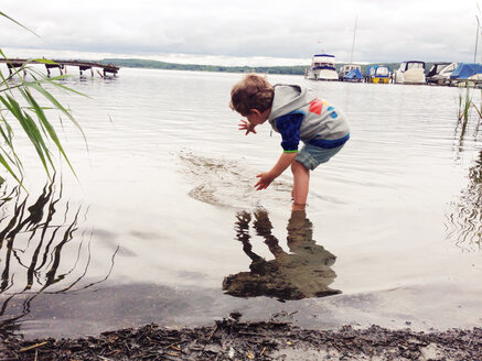 Boy wading in water - AFF000115