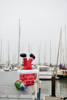 USA, California, San Francisco, boat with Santa Claus figure in harbor - BRF000743