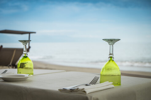 Mexico, Jalisco, Puerto Vallarta, laid table at beach front restaurant - ABAF001461