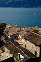Italy, Veneto, Brenzone, Marniga di Brenzone, Kite surfer on Lake Garda - LVF001822