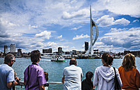 United Kingdom, England, Hampshire, Portsmouth, Harbour, Spinnaker Tower, tourists in the foreground - DIS000990