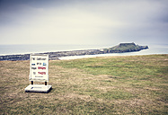 United Kingdom, Wales, Gower Peninsula, Worm's Head at low tide, sign - DISF001005