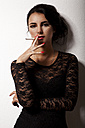 Portrait of smoking young woman with red nail polish - JUNF000034