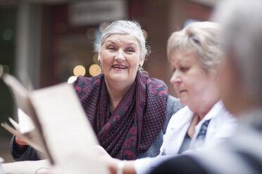 Three senior women sitting in a pavement cafe - ZEF000167