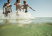 Three teenagers enjoying beachlife - UUF001695