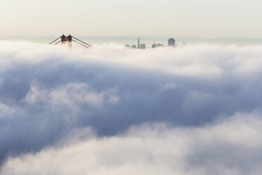 USA, California, San Francisco, skyline and Golden Gate Bridge in fog seen from Hawk Hill - FOF007012