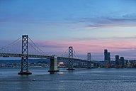 USA, California, San Francisco, Skyline and Oakland Bay Bridge in the evening - FOF007048