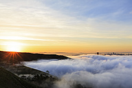 USA, California, San Francisco, skyline and Golden Gate Bridge in fog at sunrise seen from Hawk Hill - FOF007021