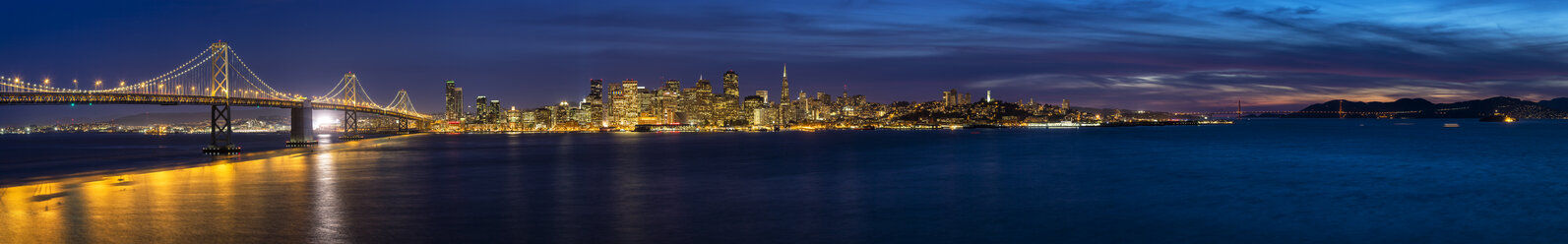 USA, California, San Francisco, Skyline and Oakland Bay Bridge in the evening - FO007055