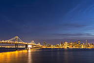 USA, California, San Francisco, Skyline and Oakland Bay Bridge in the evening - FOF007062