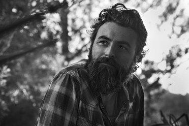 Man with full beard thinking - KOF000021