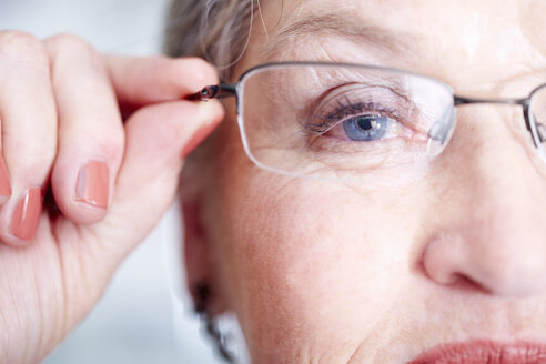 Close-up of senior woman wearing glasses - ZEF000631