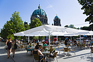 Germany, Berlin, Museum Island, Berlin Cathedral with people sitting at cafe tables - PS000629