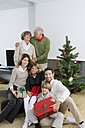 Group picture of happy three generations family at Christmas Eve - CHAF000198