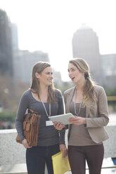 Two businesswomen communicating - ZEF000238