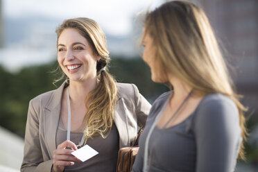Portrait of smiling businesswoman communicating with another one - ZEF000264
