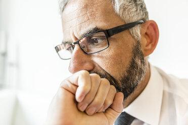 Portrait of pensive businessman - MBEF001161