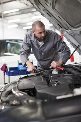 Car mechanic at work in repair garage - ZEF000560