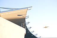South Africa, Cape Town, porch of stadium and flying airplane at the sky - ZEF000858