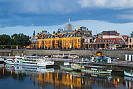 Germany, Saxony, Dresden, cityscape at dusk with paddlesteamers on River Elbe - WGF000448