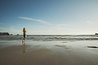 France, Brittany, Camaret-sur-Mer, teenage girl standing on beach - UUF001786