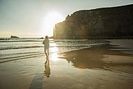 France, Brittany, Camaret-sur-Mer, senior woman standing on the beach - UUF001789