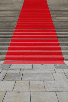 Germany, Berlin, red carpet at stone staircase - JMF000279
