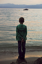 Italy, Lake Garda, boy looking at sunset - SARF000841