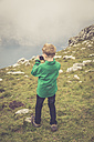 Italy, Lake Garda, Malcesine, Monte Baldo, boy taking a photo - SARF000819