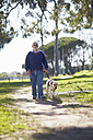 Visually impaired man walking with his guide dog in a park - ZEF000985